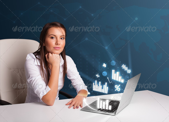 PhotoDune Pretty woman sitting at desk and typing on laptop with diagrams 3923125