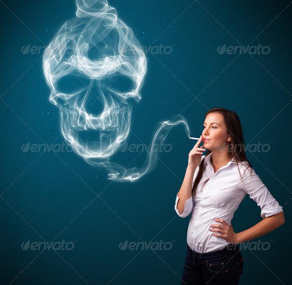 PhotoDune Young woman smoking dangerous cigarette with toxic skull smoke 3923134
