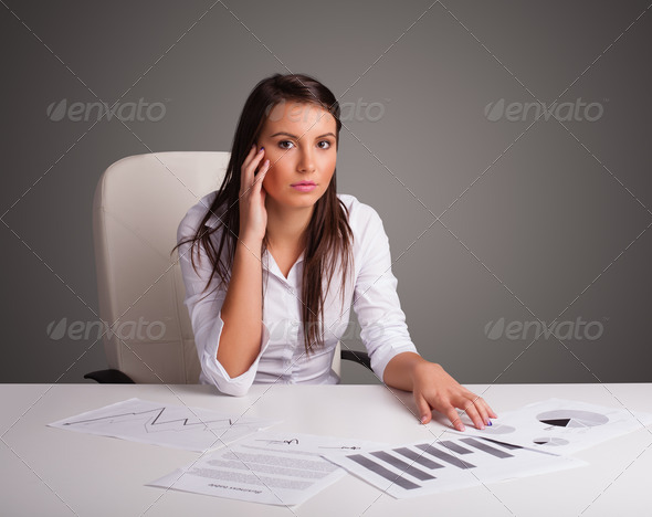 PhotoDune Businesswoman sitting at desk and doing paperwork 3923136