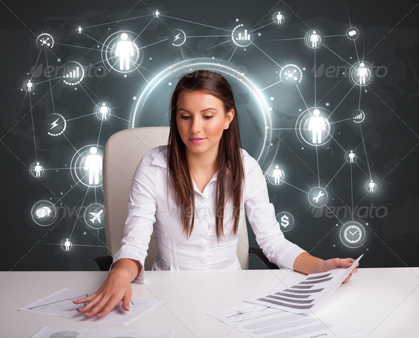 PhotoDune Businesswoman sitting at desk with social network icons 3923140