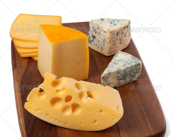 Different types of cheese on wooden board - Stock Photo - Images