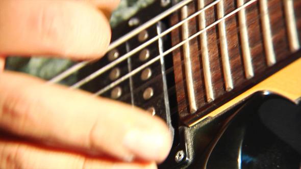 Playing At Guitar 4
