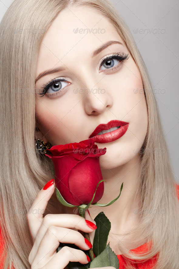 blonde woman with rose - Stock Photo - Images