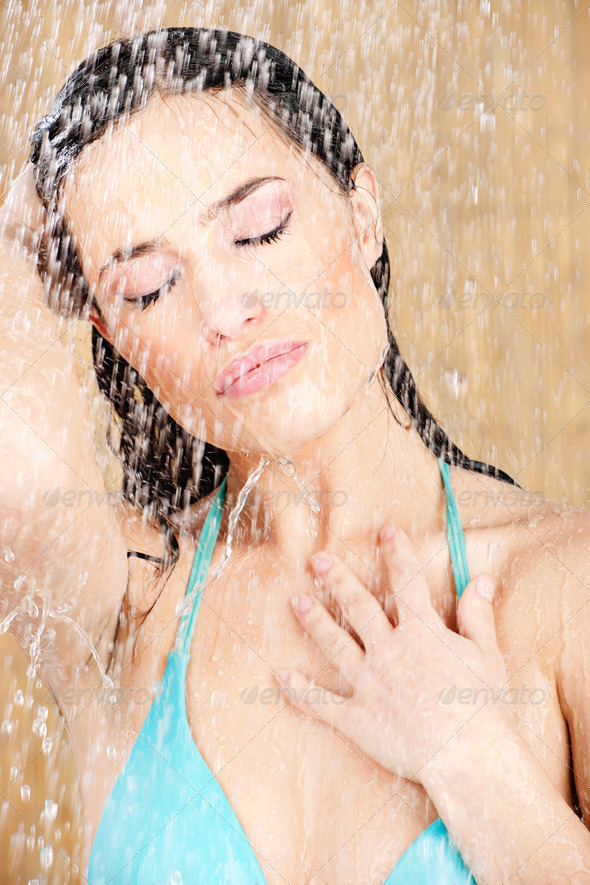 Pretty sensual woman having a shower - Stock Photo - Images
