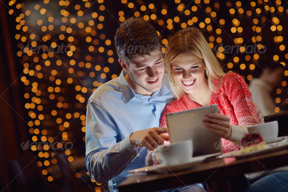 PhotoDune young couple with a tablet computer 3939154