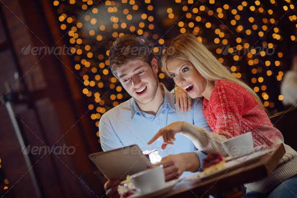 PhotoDune young couple with a tablet computer 3939157