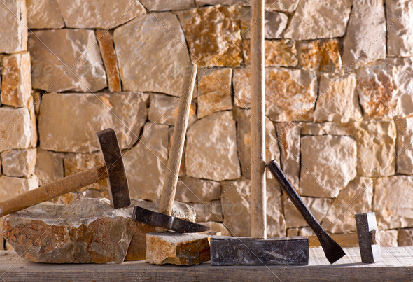 Hammer tools of stonecutter masonry work - Stock Photo - Images