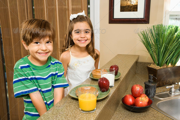 Kids eating breakfast - Stock Photo - Images