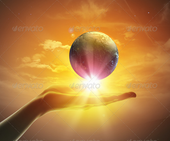 Image of earth planet on hand - Stock Photo - Images
