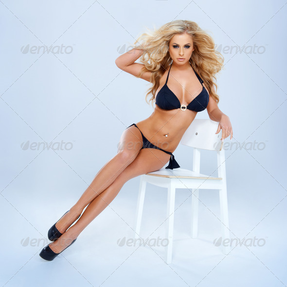 Blonde Woman In Bikini Sitting On Chair - Stock Photo - Images