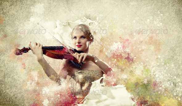 Gorgeous woman playing on violin - Stock Photo - Images
