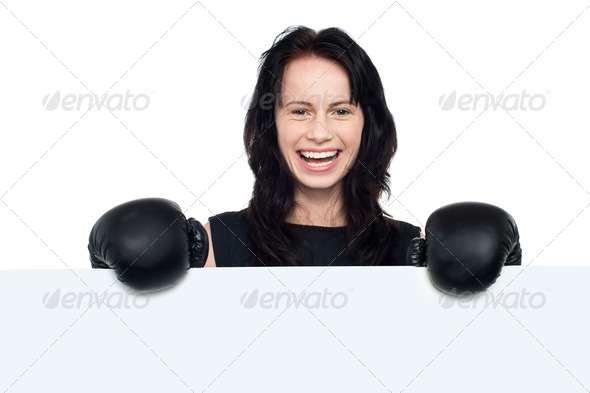 PhotoDune Woman with boxing gloves on posing behind billboard 3960168