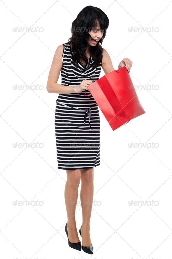 PhotoDune Young woman searching for her gift inside bag 3960184