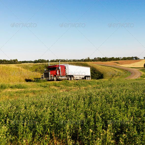 PhotoDune Semi truck on rural road 427737
