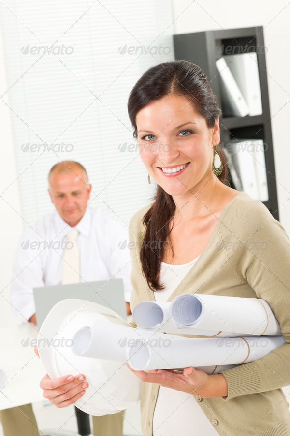 Professional architect woman with blueprint office - Stock Photo - Images