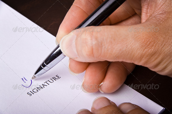 PhotoDune Human hand with pen signing a document 3969938