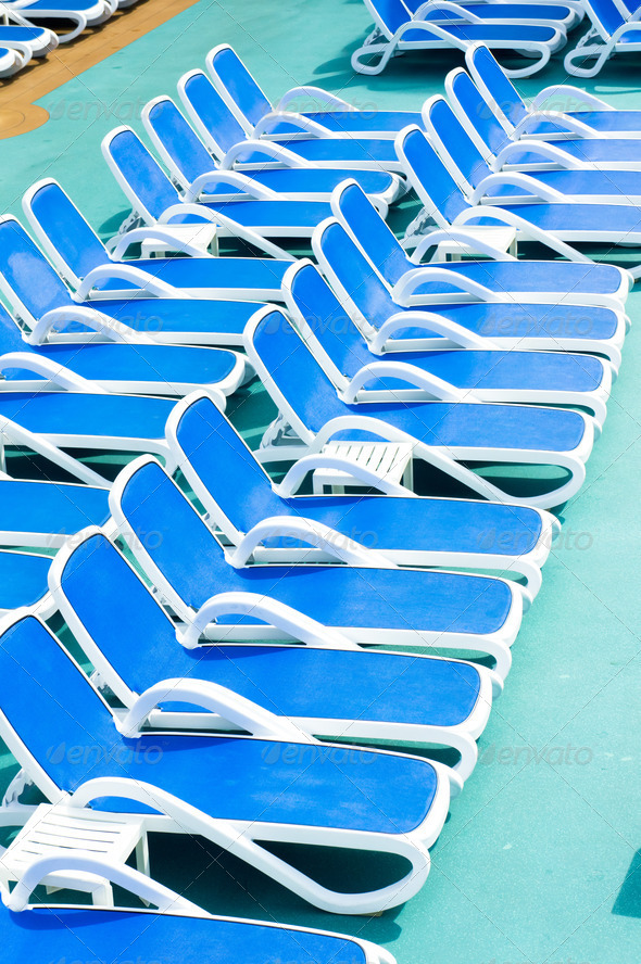 PhotoDune Close up view of blue deck chairs 3969944
