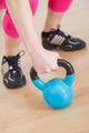 Hand grabbing fitness equipment
