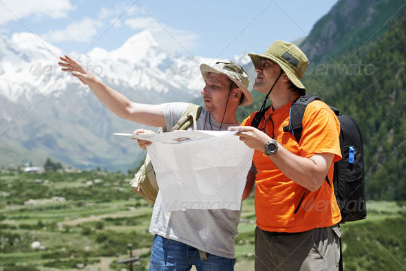 Tourist travellers with map in mountains - Stock Photo - Images