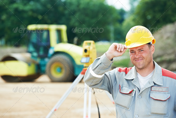 surveyor works with theodolite - Stock Photo - Images