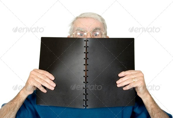 casual teacher with black notebook - Stock Photo - Images