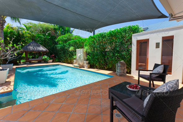 Backyard with swimming pool - Stock Photo - Images