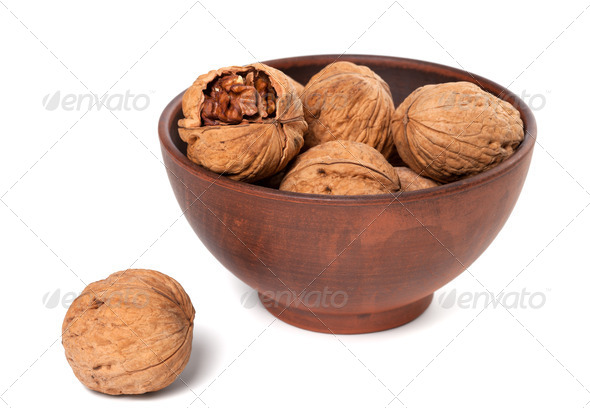 Walnuts in ceramic plate - Stock Photo - Images