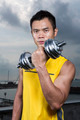 Athletic Young Chinese man exercising outdoors with dumbbells - PhotoDune Item for Sale