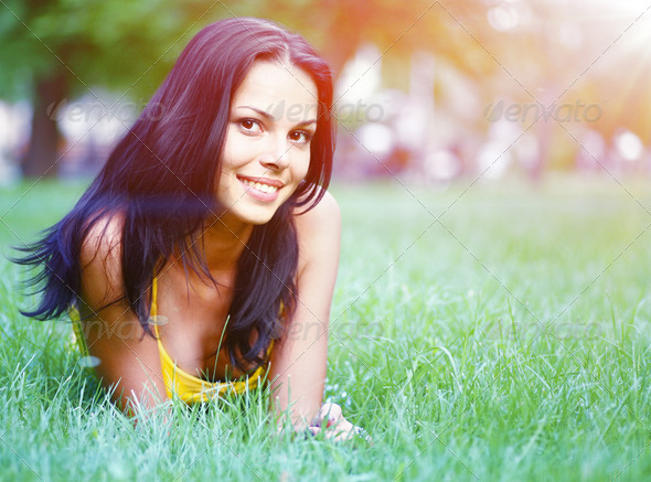 sexy brunette on grass - Stock Photo - Images