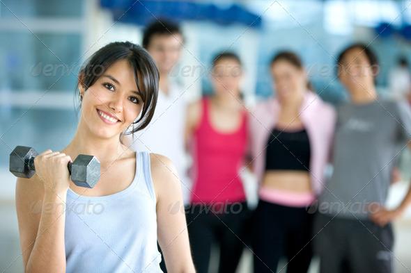 woman lifting free weights - Stock Photo - Images
