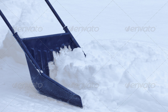 Manual snow removal with snow scoop after blizzard - Stock Photo - Images