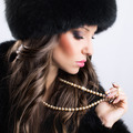 Beautiful woman wearing luxury fur coat and hat - PhotoDune Item for Sale