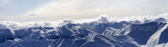 Panorama of evening mountains in haze - Stock Photo - Images