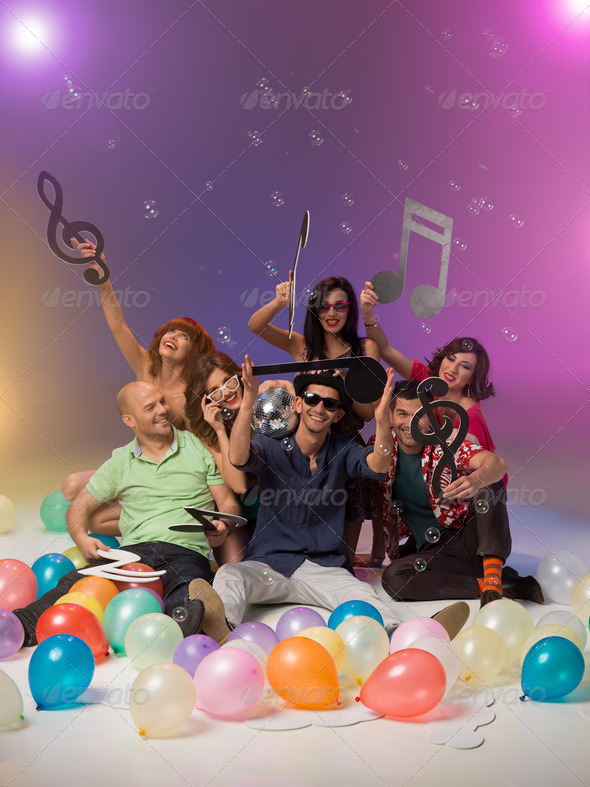group of friends with musical notes and balloons - Stock Photo - Images