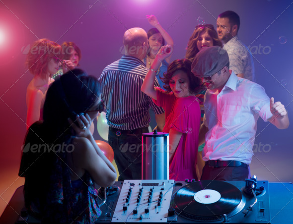 young couple dancing at party with female dj - Stock Photo - Images
