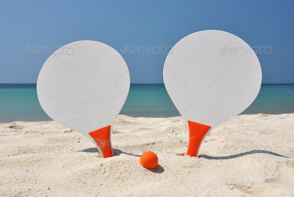 PhotoDune Two racket and a ball on the sandy beach 4001872