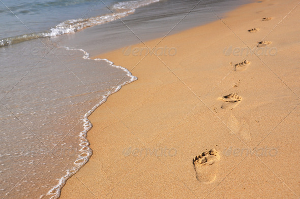 PhotoDune Footmarks on the sandy beach 4001887