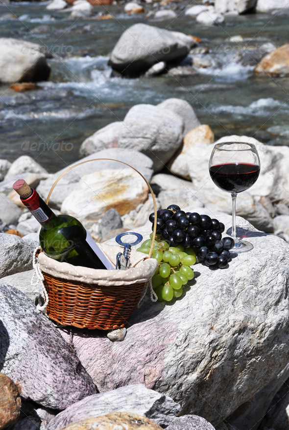 PhotoDune Red wine cheese and grapes served at a picnic Verzasca valley 4001901