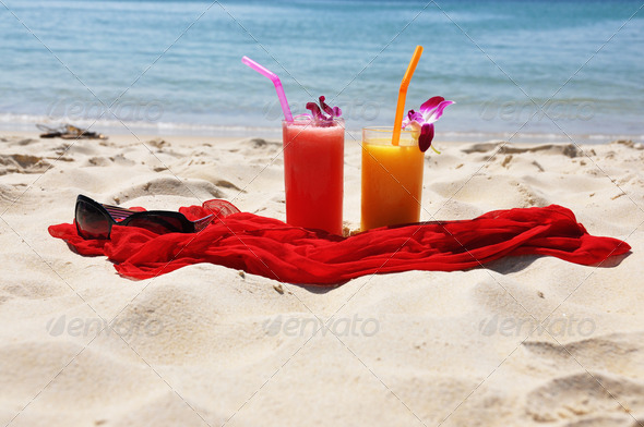 PhotoDune Pair of fruit shakes red shawl and sunglasses on the tropical b 4001902
