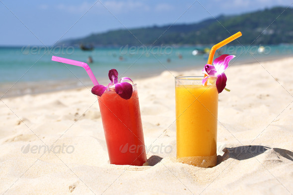PhotoDune Pair of fruit shakes on the tropical beach 4001912