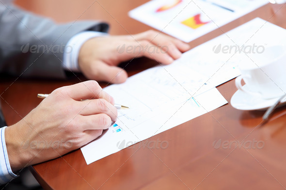 PhotoDune Hands of businessman writing 4004917