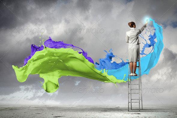 Young woman drawing splashes - Stock Photo - Images