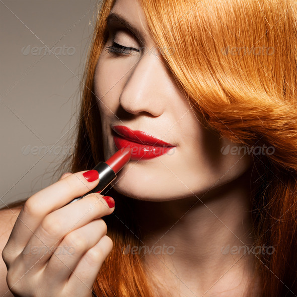 Close-Up Portrait Of Beautiful Woman With Red Lipstick - Stock Photo - Images