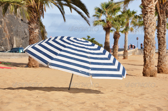 PhotoDune Striped umbrella on the Teresitas beach of Tenerife island Cana 4021131