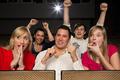 Audience in cinema cheering