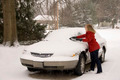 Woman Removing Snow From Car 3 - PhotoDune Item for Sale