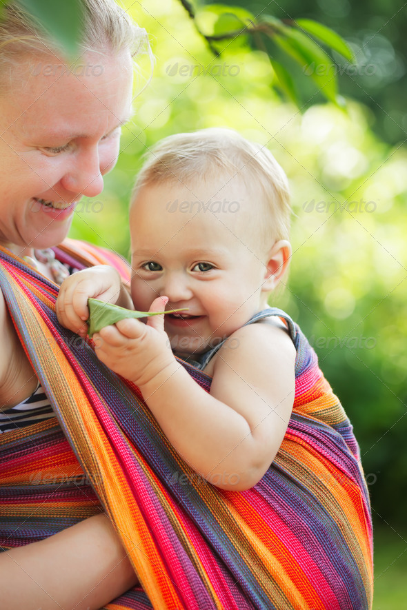 Baby in sling - Stock Photo - Images