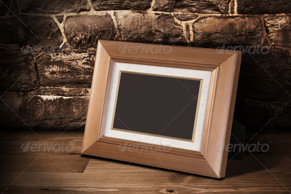 Frame on the shelf with place for photo 4 - Stock Photo - Images