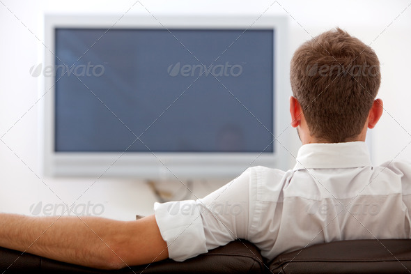 PhotoDune man and plasma tv 435002