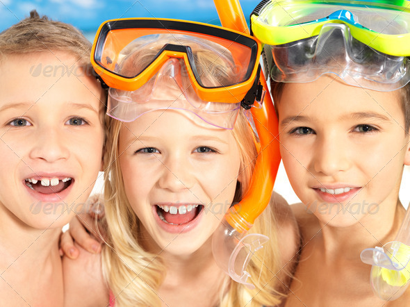 Portrait of the happy children enjoying at beach - Stock Photo - Images